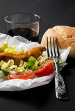 Fish sandwich with greenery, tomatoes and salad Royalty Free Stock Images