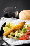 Fish sandwich with greenery, tomatoes and salad Royalty Free Stock Photography