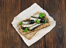Fish sandwich with sprats and olives Stock Photo