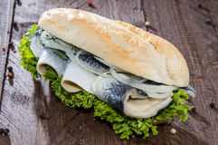Fish Sandwich on wooden background Stock Photo
