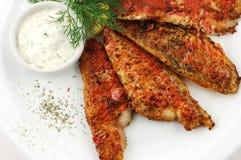 Fish with sauce Stock Photos