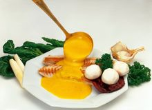 Fish with sauce. Fish meal served on plate stock images