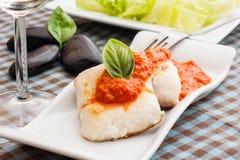 Fish on sauce Stock Photography