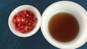 Fish sauce and chilli. Fish sauce and red chilli stock video footage
