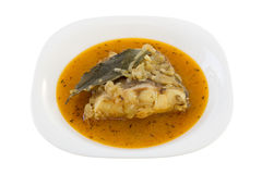 Fish in sauce on the plate Stock Images