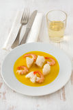 Fish in sauce of saffron Stock Images