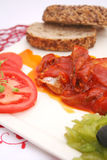 Fish with a sauce of tomatoes Royalty Free Stock Photos