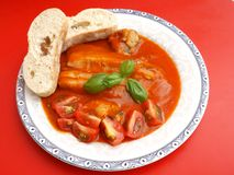 Fish with a sauce of tomatoes Stock Image