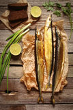 Fish saury smoked on wooden background Royalty Free Stock Images