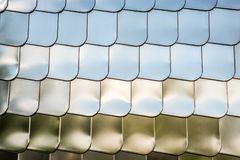 Fish scale texture silver metal shape wall cover chrome reflection background. Fish scale texture silver metal shape wall cover with chrome reflection background Stock Image