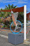 Fish Sculpture resembling swordfish outside of Noumea Wet Market with shade cover & green trees in the background Stock Image