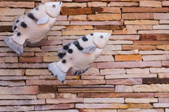 Fish sculpture on the wall Royalty Free Stock Photography