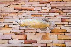 Fish sculpture on the wall Stock Images