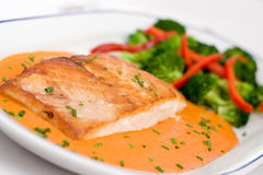 Fish (sea bass) fillet 2. Fish (sea bass) fillet with red paprika sauce royalty free stock images