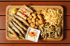 Fish and sea fruits snacks board for beer Royalty Free Stock Images