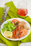 Fish with seafood on the plate Stock Photography