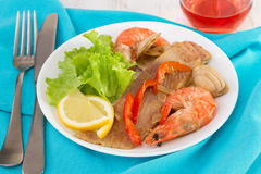 Fish with seafood and salad Stock Photography