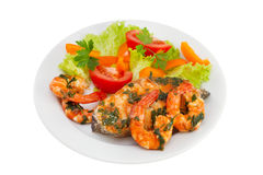 Fish with seafood and salad on the plate Stock Photo