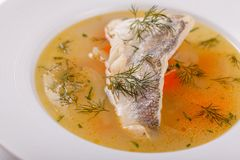 Fish and seafood soup . Delicious soup with white fish and vegetables for dinner. Fish and seafood soup . Delicious soup with white cod fish and vegetables for royalty free stock images