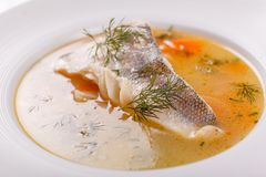 Fish and seafood soup . Delicious soup with white fish and vegetables for dinner. Fish and seafood soup . Delicious soup with white cod fish and vegetables for royalty free stock photo