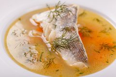 Fish and seafood soup . Delicious soup with white fish and vegetables for dinner. Fish and seafood soup . Delicious soup with white cod fish and vegetables for royalty free stock photography