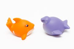 Fish and seal toys. On white background Royalty Free Stock Images