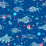 Fish seamless pattern. With bright splash on blue background Royalty Free Stock Photo