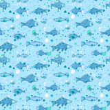 Fish seamless pattern. With splash on blue background Royalty Free Stock Images