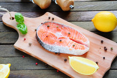 Fish and the seasoning on the board Stock Photos
