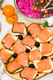 Fish served for celebration dinner. Celebration table served with dishes containing fish, salads, fruits, vegetables Royalty Free Stock Photography