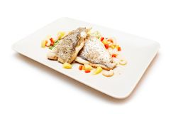 Fish served with shrimps and vegetables Stock Photography