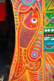 Fish shape on a pakistani truck. Decorated pakistani truck decoration front side backside art artist paint painter flower heart culture wheels auto bedford stock photography