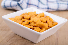 Fish shaped cheddar crackers. Bowl Stock Photos
