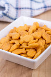 Fish shaped cheddar crackers. Bowl Stock Photo