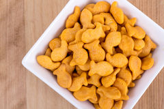Fish shaped cheddar crackers. Bowl on table high angle view Stock Photos