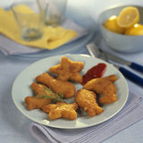 Fish-shaped fish fingers Stock Images