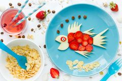Fish shaped fruit plate. Healthy snack for kids Stock Images