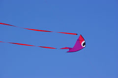 Fish-shaped kite against blue sky Stock Photography