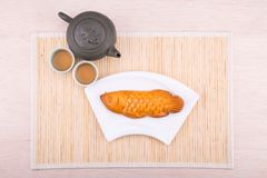 Fish shaped moon cake pastries for Chinese mid-autumn celebration. Served with Chinese tea Stock Image