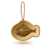 Fish shaped tag with handwritten word Seafood. Stock Photography
