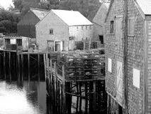 Fish sheds in the cove. Fishing sheds on stilts on the shore of the cove Royalty Free Stock Photo