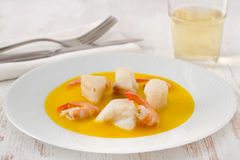 Fish with shrimps in sauce Stock Photo