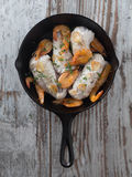 Fish and shrimps. Vertical view of fish and shrimps with garlic in a wooden table Royalty Free Stock Photography