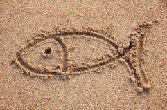 Fish sign. Drawn on a beach Stock Photo