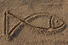 Fish sign in sand. Closeup of a fish sign in sand on a beach Stock Photos