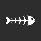 Fish skeleton vector pictogram. On black background Stock Photos