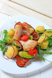 Fish skewer with potato side dish Stock Image