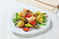 Fish skewer with potato side dish Stock Photo