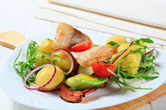 Fish skewer with potato side dish Royalty Free Stock Images