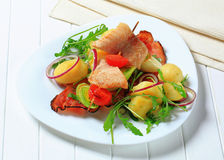 Fish skewer with potato side dish Royalty Free Stock Photos